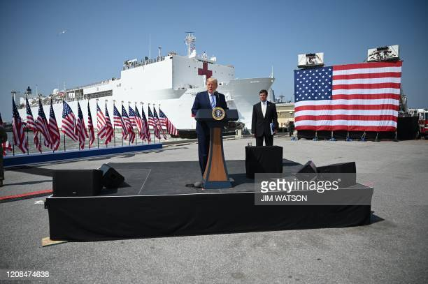 US President Donald Trump speaks as US Defense Secretary Mark Esper listens during the departure ceremony for the hospital ship USNS Comfort at Naval...