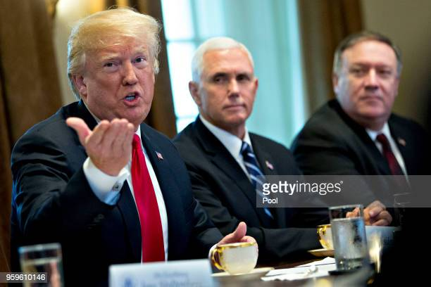 US President Donald Trump speaks as US Vice President Mike Pence center and Mike Pompeo US secretary of state listen during a meeting with Jens...