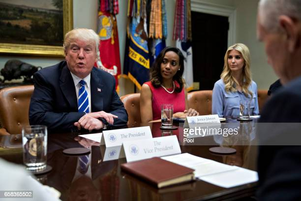 S President Donald Trump speaks as US Vice President Mike Pence from right Ivanka Trump daughter of Trump and Jessica Johnson president of Johnson...