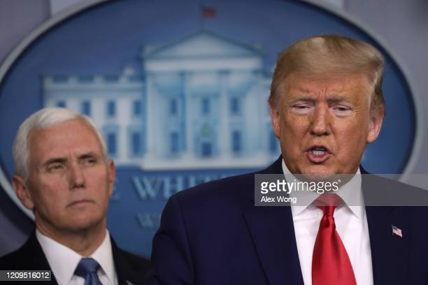President Donald Trump speaks as Vice President Mike Pence looks on during a news conference at the James Brady Press Briefing Room at the White...
