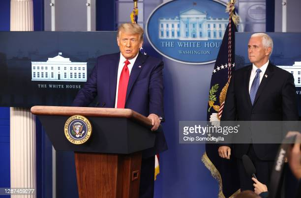President Donald Trump speaks as Vice President Mike Pence looks on in the James Brady Press Briefing Room at the White House on November 24, 2020 in...