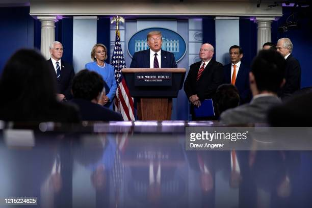 S President Donald Trump speaks as Vice President Mike Pence Secretary of Education Betsy DeVos and Secretary of Agriculture Sonny Perdue look on...