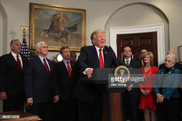 S President Donald Trump speaks as Vice President Mike Pence Sen Rand Paul Secretary of Labor Alexander Acosta and Rep Virginia Foxx look on during...