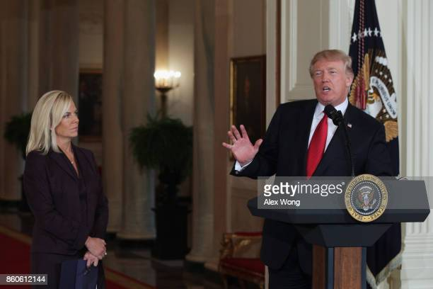 S President Donald Trump speaks as White House Deputy Chief of Staff Kirstjen Nielsen looks on during a nomination announcement at the East Room of...