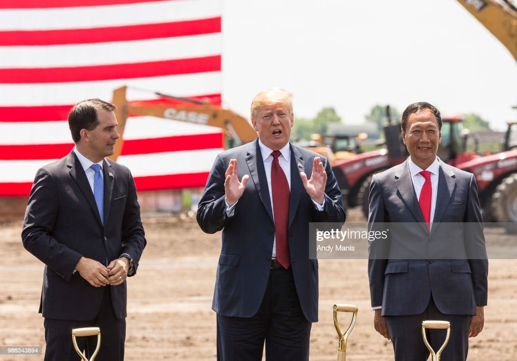 U.S. President Donald Trump (C) speaks as Wisconsin Gov. Scott Walker (L) and Foxconn CEO Terry Gou look on at the groundbreaking for the Foxconn Technology Group computer screen plant on June 28, 2018 in Mt Pleasant, Wisconsin. Foxconn has committed to build a $10 billion plant in what it has named the Wisconn Valley Science and Technology Park, and to creating 13,000 Wisconsin jobs.