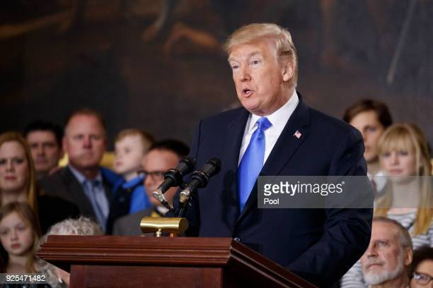 President Donald Trump speaks at a ceremony honoring Reverend Billy Graham as he lies in repose at the US Capitol on February 28 2018 in Washington...