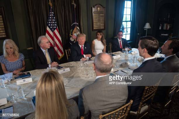 US President Donald Trump speaks at a meeting with administration officials on the opioid addiction crisis at the Trump National Golf Club in...