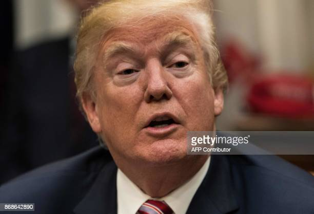 US President Donald Trump speaks at a meeting with business leaders on tax reform at the White House in Washington DC on October 31 2017 KAMM