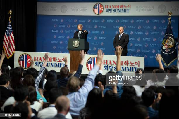 S President Donald Trump speaks at a news conference while Mike Pompeo US secretary of state looks on following his second summit meeting with North...