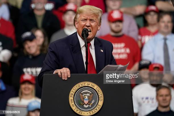 S President Donald Trump speaks at a rally at Southern New Hampshire University Arena on February 10 2020 in Manchester New Hampshire New Hampshire...