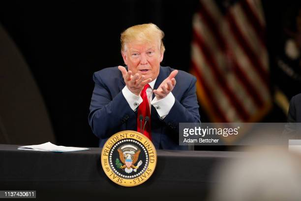 S President Donald Trump speaks at a roundtable on the economy and tax reform at Nuss Trucking and Equipment on April 15 2019 in Burnsville Minnesota...