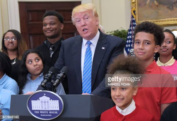 US President Donald Trump speaks at a school choice event with Education Secretary Betsy DeVos in the Roosevelt Room of the White House on May 3 2017...