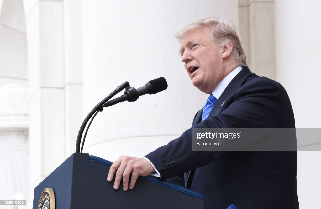 U.S. President Donald Trump speaks at a wreath laying ceremony at the Tomb of the Unknown Soldier at Arlington National Cemetery in Arlington, Virginia, U.S., on Monday, May 29, 2017. On Memorial Day, Trump visited Arlington National Cemetery to honor the memory of fallen service men and women. Photographer: Olivier Douliery/Pool via Bloomberg