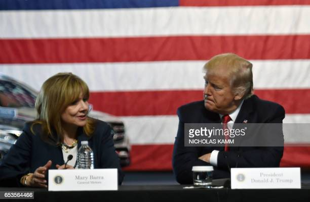 US President Donald Trump speaks at American Center for Mobility in Ypsilanti Michigan with General Motors CEO Mary Barra on March 15 2017 / AFP...
