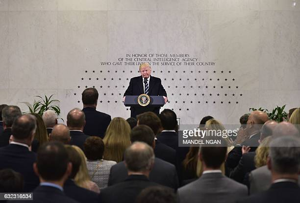 US President Donald Trump speaks at CIA Headquarters in Langley Virginia on January 21 2017 'I am with you 1000 percent' Trump said in a short...