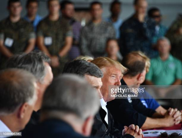 US President Donald Trump speaks at Marine Corps Air Station Cherry Point in North Carolina where he will tour areas of the eastern state pummeled by...