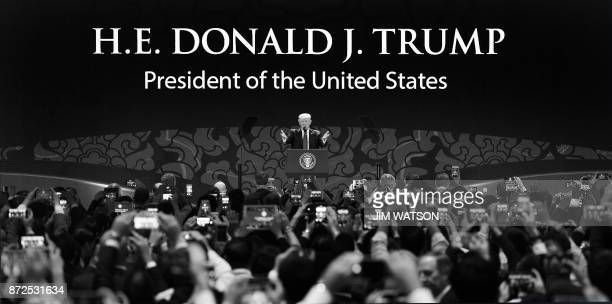 US President Donald Trump speaks at the APEC CEO Summit at Ariyana Da Nang Exhibition Center in Danang on November 10 2017 / AFP PHOTO / JIM WATSON