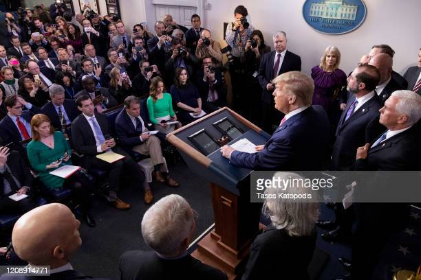 President Donald Trump speaks at the beginning of a new conference with members of the coronavirus task force, including Vice President Mike Pence,...