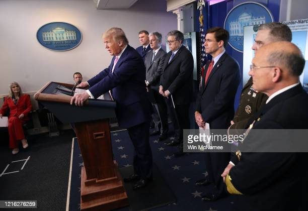 S President Donald Trump speaks at the press briefing room flanked by US Coast Guard Commandant Admiral Karl Schultz National Security Advisor Robert...