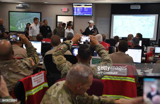President Donald Trump speaks at the Texas Department of Public Safety Emergency Operations Center in Austin Texas on August 29 as rains from...