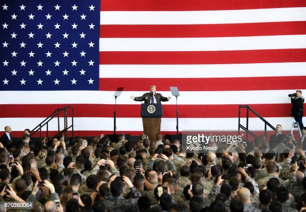 US President Donald Trump speaks before a crowd at US Yokota Air Base in the suburbs of Tokyo on Nov 5 after arriving in Japan for the first time...