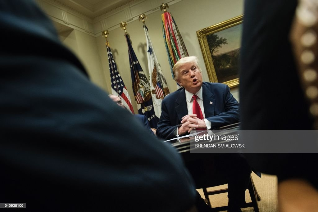 US President Donald Trump speaks before a meeting with health insurance executives in the Roosevelt Room of the White House February 27, 2017 in Washington, DC. / AFP / Brendan Smialowski