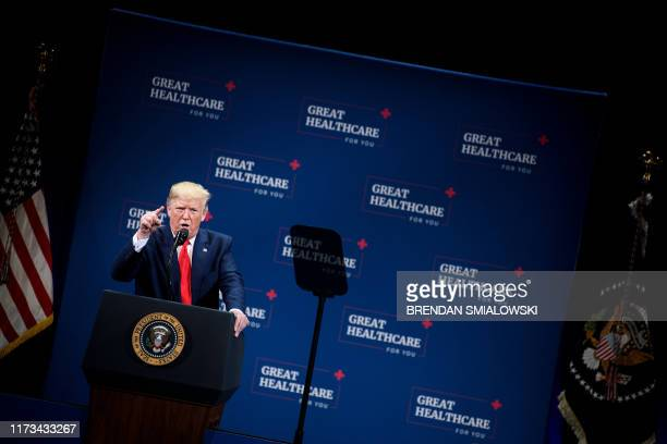 US President Donald Trump speaks before an executive order signing regarding Medicare at Sharon L Morse Performing Arts Center October 3 in The...