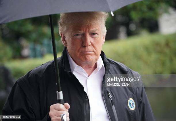 US President Donald Trump speaks before boarding Marine One from the South Lawn of the White House in Washington DC on October 15 2018 Trump is...