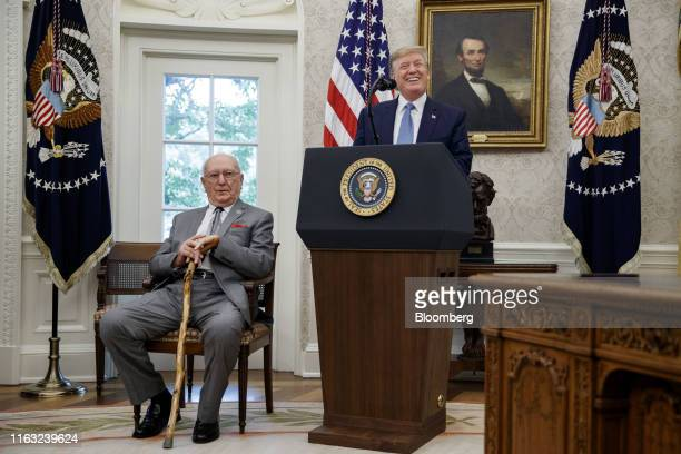 US President Donald Trump speaks before presenting the Presidential Medal of Freedom to Robert Cousy former National Basketball Association player...