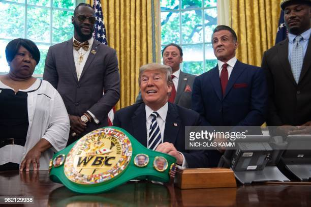 US President Donald Trump speaks before signing a posthumous pardon for former world champion boxer Jack Johnson in the Oval Office at the White...