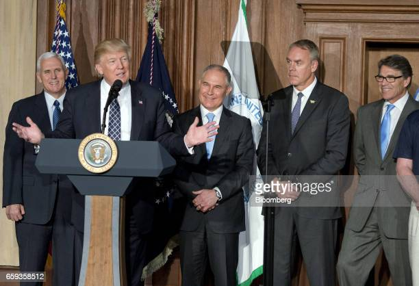 US President Donald Trump speaks before signing an energy independence executive order as US Vice President Mike Pence from left Scott Pruitt...
