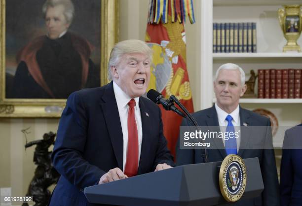 US President Donald Trump speaks before signing an executive order regarding trade in the Oval Office of the White House in Washington DC US March 31...