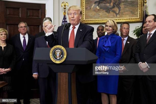 US President Donald Trump speaks before signing an executive order on health care in the Roosevelt Room of the White House in Washington DC US on...