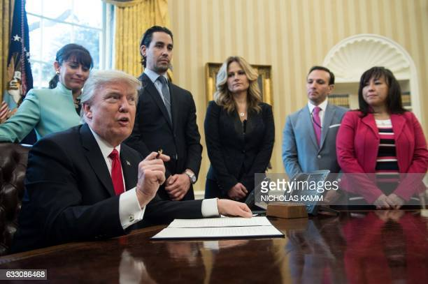 US President Donald Trump speaks before signing an executive order with small business leaders in the Oval Office at the White House in Washington DC...