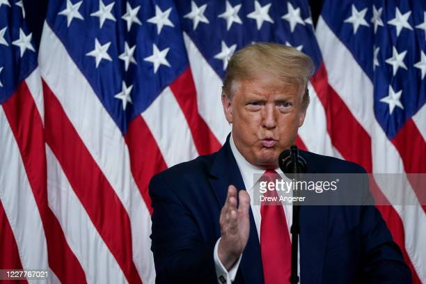 President Donald Trump speaks before signing executive orders on prescription drug prices in the South Court Auditorium at the White House on July...