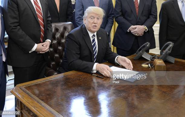 US President Donald Trump speaks before signing HJ Res 41 in the Oval Office of the White House on February 14 2017 in Washington DC The resolution...
