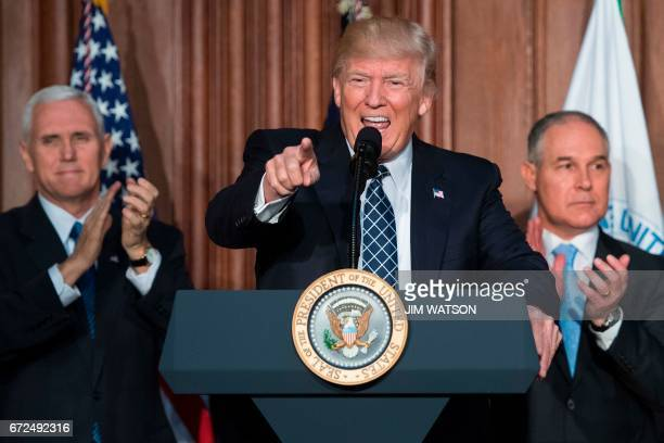 US President Donald Trump speaks before signing the Energy Independence Executive Order at the Environmental Protection Agency Headquarters in...