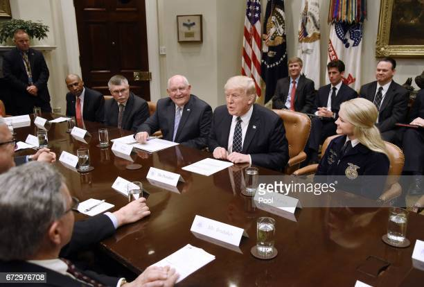 US President Donald Trump speaks before signing the Executive Order Promoting Agriculture and Rural Prosperity in America during a roundtable with...