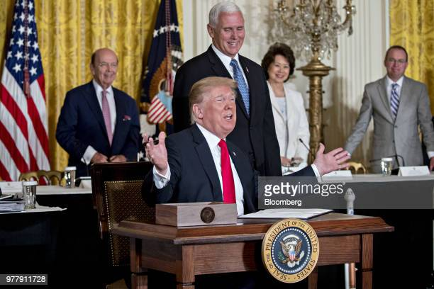 US President Donald Trump speaks before signing the Space Policy Directive3 next to US Vice President Mike Pence center right during a National Space...