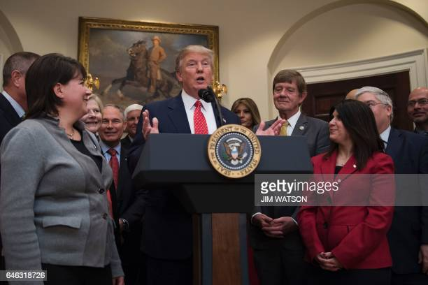 US President Donald Trump speaks before signing the the Waters of the US executive order aimed at killing the Obama administration's contentious...