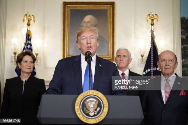 US President Donald Trump speaks before signing trade sanctions against China on March 22 in the Diplomatic Reception Room of the White House in...