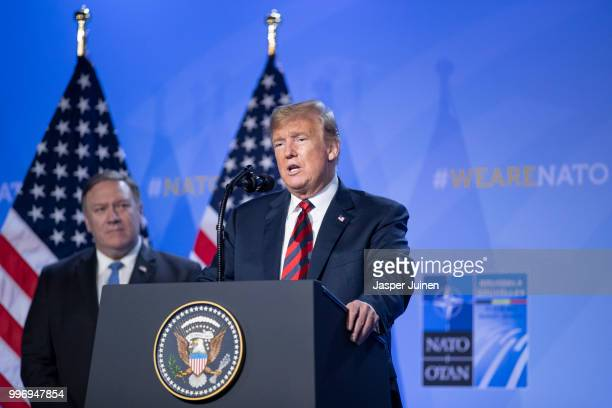 S President Donald Trump speaks besides US Secretary of State Mike Pompeo during a news conference at the 2018 NATO Summit at NATO headquarters on...