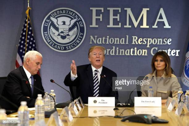 US President Donald Trump speaks between US Vice President Mike Pence and First Lady Melania Trump during a 2018 Hurricane Briefing at the Federal...