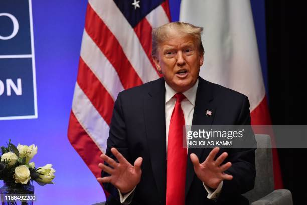US President Donald Trump speaks during a bilateral meeting with Italy's Prime Minister Giuseppe Conte at the NATO summit at the Grove hotel in...