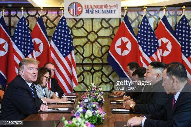 US President Donald Trump speaks during a bilateral meeting with North Korea's leader Kim Jong Un at the second USNorth Korea summit at the Sofitel...