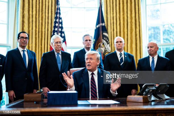 President Donald Trump speaks during a bill signing ceremony for H.R. 748, the CARES Act in the Oval Office of the White House on March 27, 2020 in...
