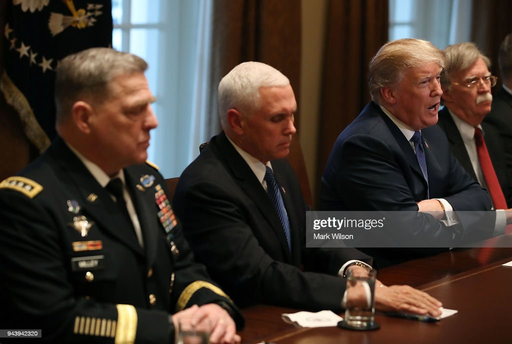 U.S. President Donald Trump speaks during a briefing from senior military leaders regarding Syria, in the Cabinet Room, on April 9, 2018 in Washington, DC. Also pictured is Chief of Staff of the U.S. Army Mark Milley (L), Vice President Mike Pence, (2nd-L), and National Security Advisor John Bolton (R).