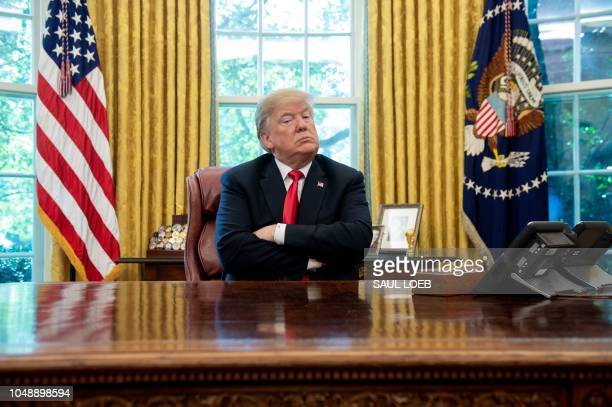 President Donald Trump speaks during a briefing on Hurricane Michael in the Oval Office of the White House in Washington DC October 10 2018