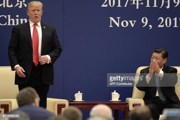 President Donald Trump speaks during a business meeting with Chinese President Xi Jinping at the Great Hall of the People in Beijing on November 9...