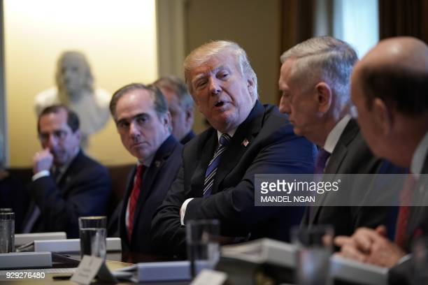 President Donald Trump speaks during a Cabinet meeting in the Cabinet Room of the White House on March 8, 2018 in Washington, DC. / AFP PHOTO /...
